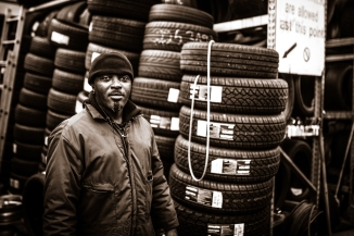 Professional Black man who replaces tires of vehicles.