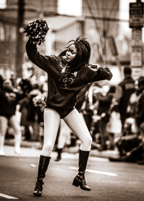 Young black girl dancing during MLK parade.