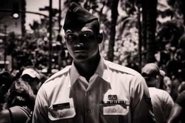 Airman Harvey walks down the street, Honolulu 2014.