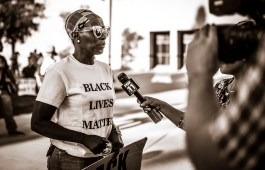 """Black Lives Matter activist, sheds a tear when reporters ask questions on """"How do you feel"""" about Philando Castille."""