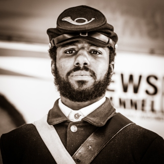 Young black man serving as a 54th Massachusetts Civil War Soldier during MLK Birthday March in Washington D.C.